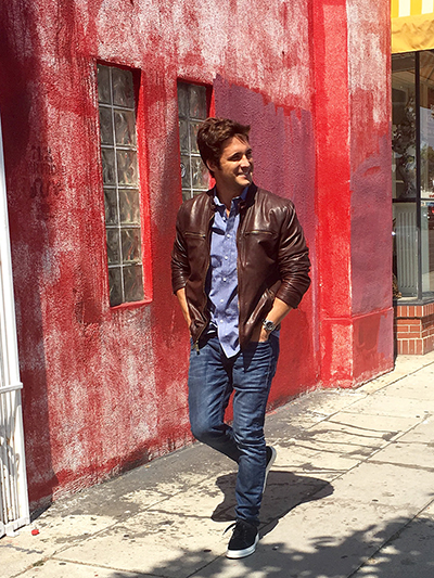 Diego Boneta wears a Vince Camuto Men's leather jacket,  Welt Pocket Shirt  and  Quort Suede Sneakers .