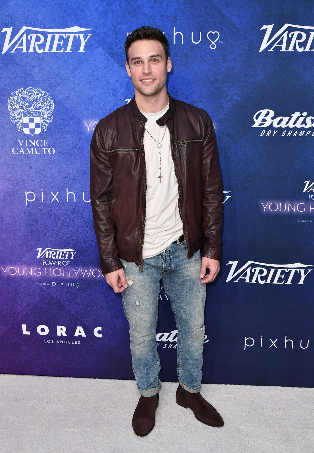 Ryan Guzman wears a Vince Camuto Perforated Leather Jacket, Slim-Fit 5-Pocket Pants and Bradbury Boots.