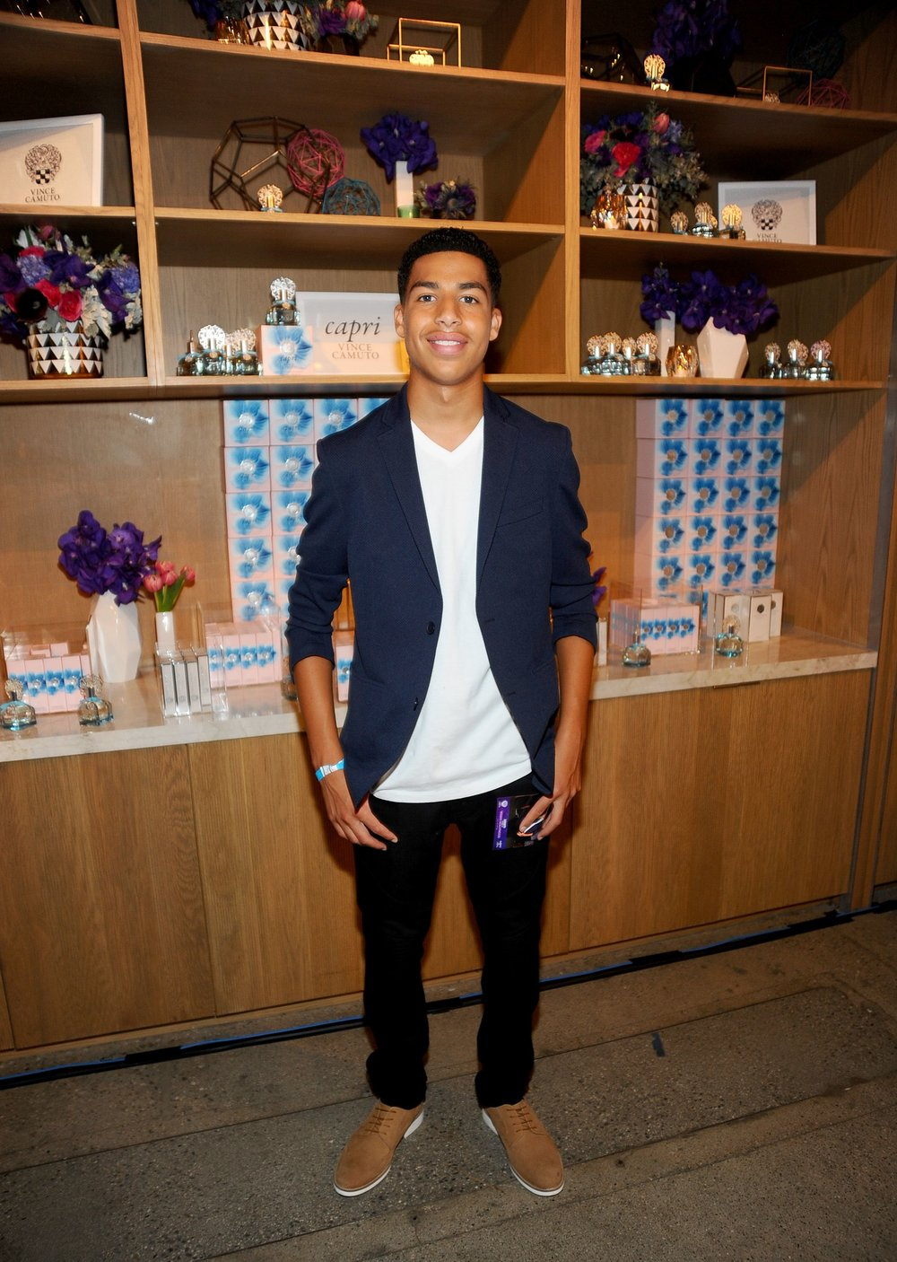 Marcus Scribner wears a Vince Camuto Mesh Blazer and Apexx Derbies.