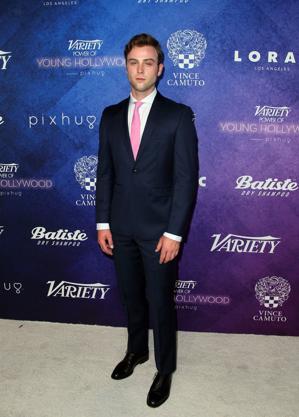 Sterling Beaumon wears a Vince Camuto Navy Slim Fit Suit and Eeric Oxfords.