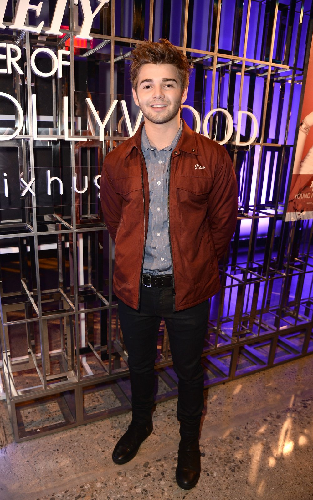 Jack Griffo wears a Vince Camuto Dobby-Striped Short Sleeve Shirt.