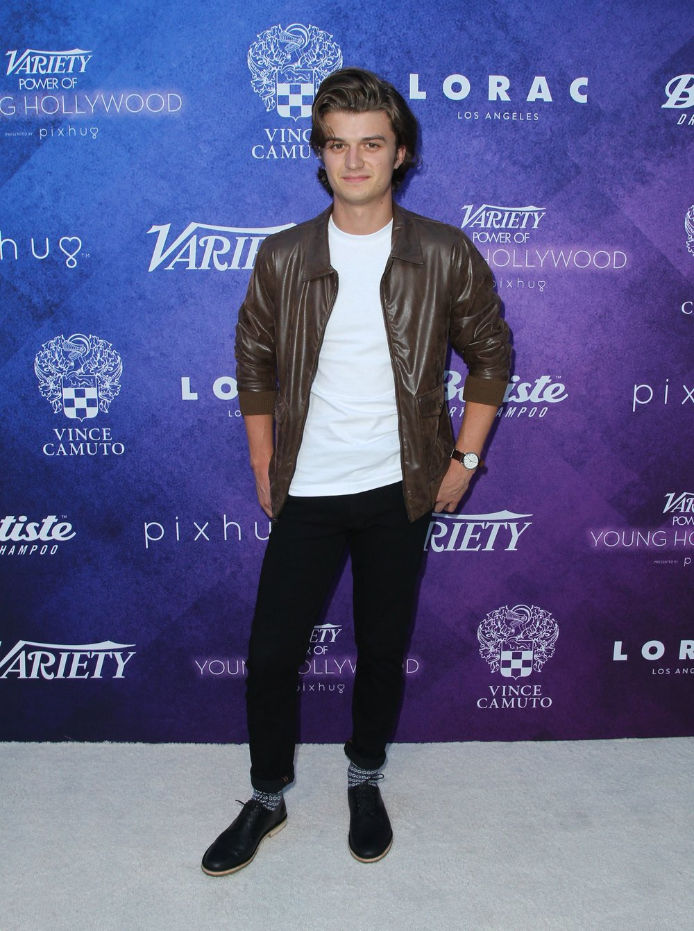 Joey Keery wears Vince Camuto Horven Derbies.