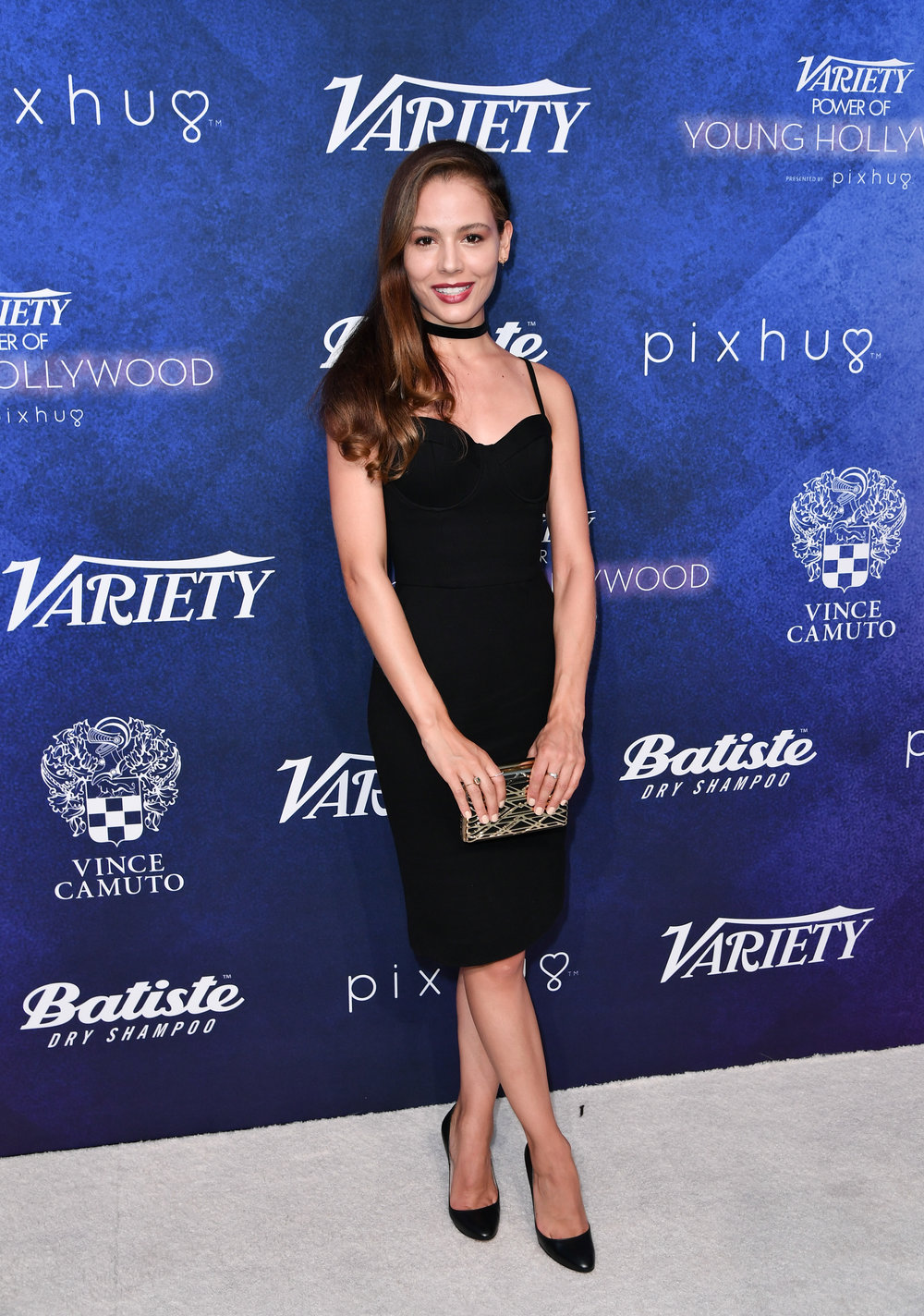 Martina García carries a Vince Camuto Zhara Clutch.