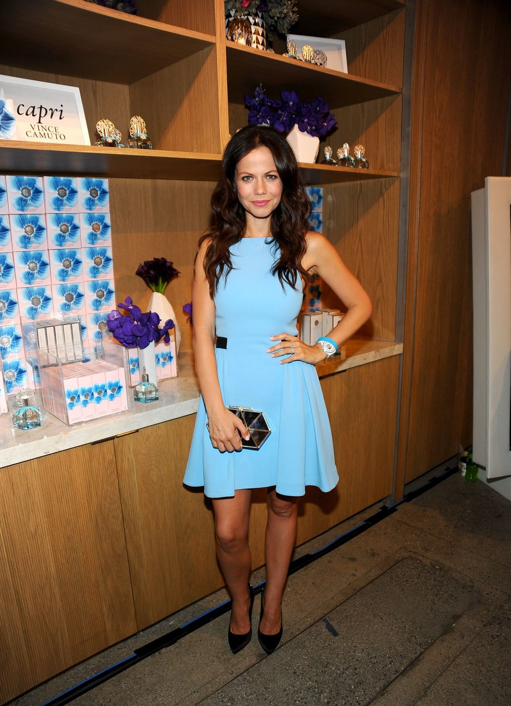 Tammin Sursok carries the Vince Camuto Aleni Clutch and wears Louise et Cie pumps.