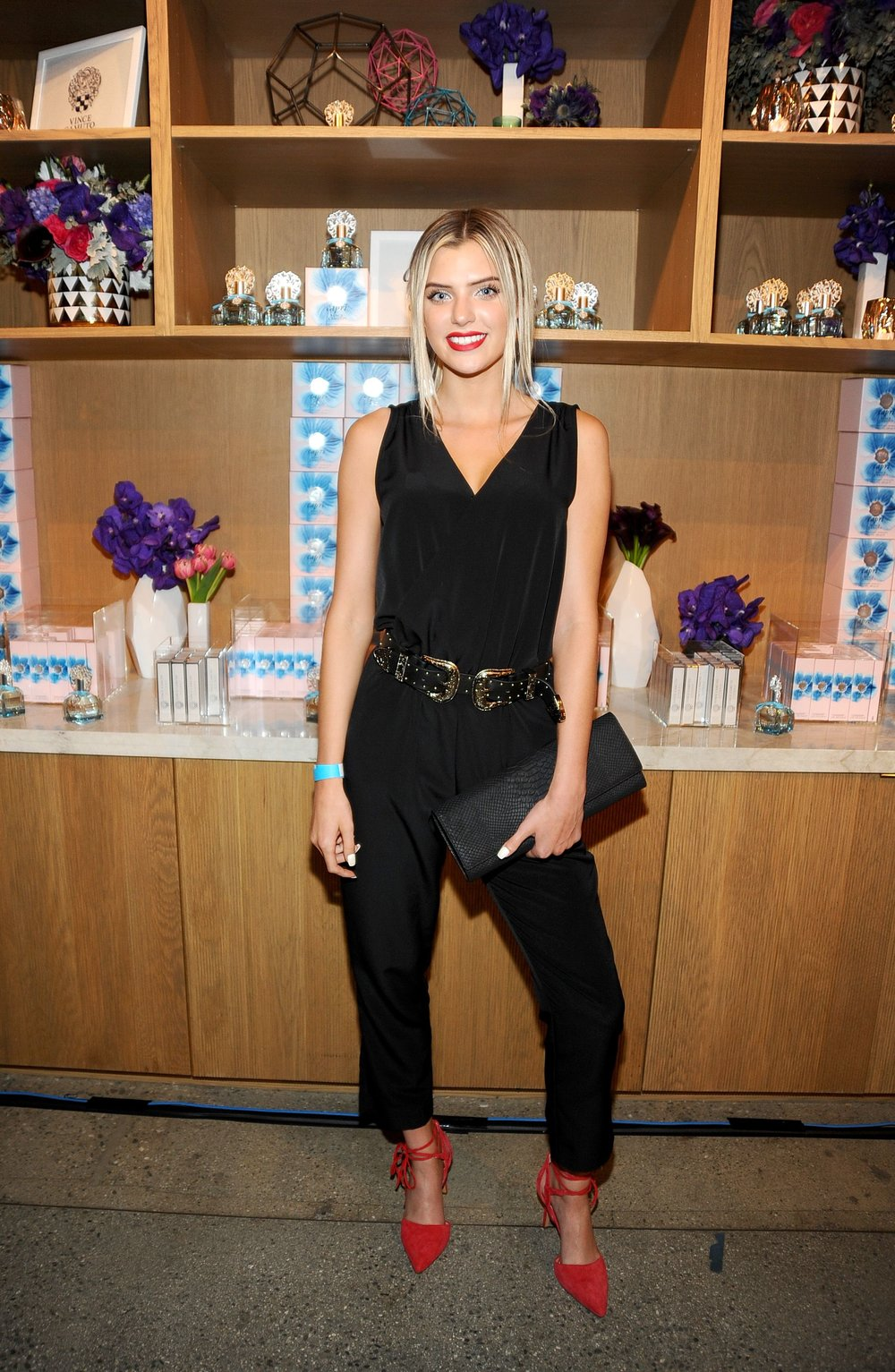 Alissa Violet wears a Vince Camuto jumpsuit and Vince Camuto Bellamy Heels.