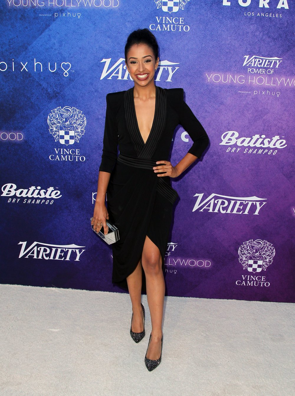 Liza Koshy carries the Vince Camuto Aleni Clutch and wears Imagine Vince Camuto Olsen Pumps.