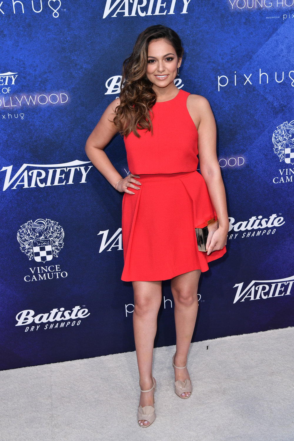 Bethany Mota carries the Vince Camuto Aleni Clutch.
