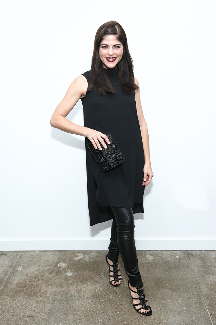 Selma Blair wears a Vince Camuto Flyaway Dress, Blane Clutch and Imagine Vince Camuto Reya Sandals.