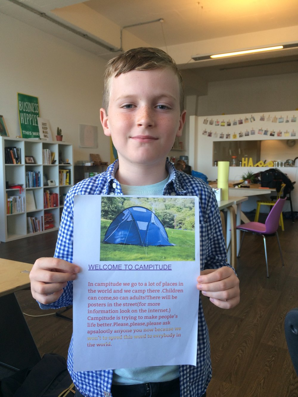 Seamus with his poster for 'Camptitude', which he'd created himself.