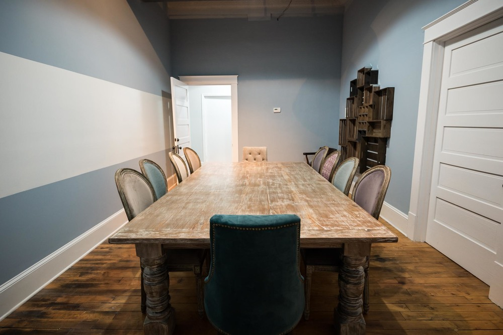 Gorgeous conference room available for rental at The CoOperative, Graham, NC's premiere coworking space.