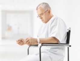 stock-photo-39962504-worried-mature-patient-sitting-in-a-hospital-corridor.jpg