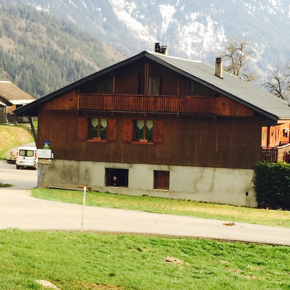 Haute-Savoie farmhouse with views of the alps in the background.