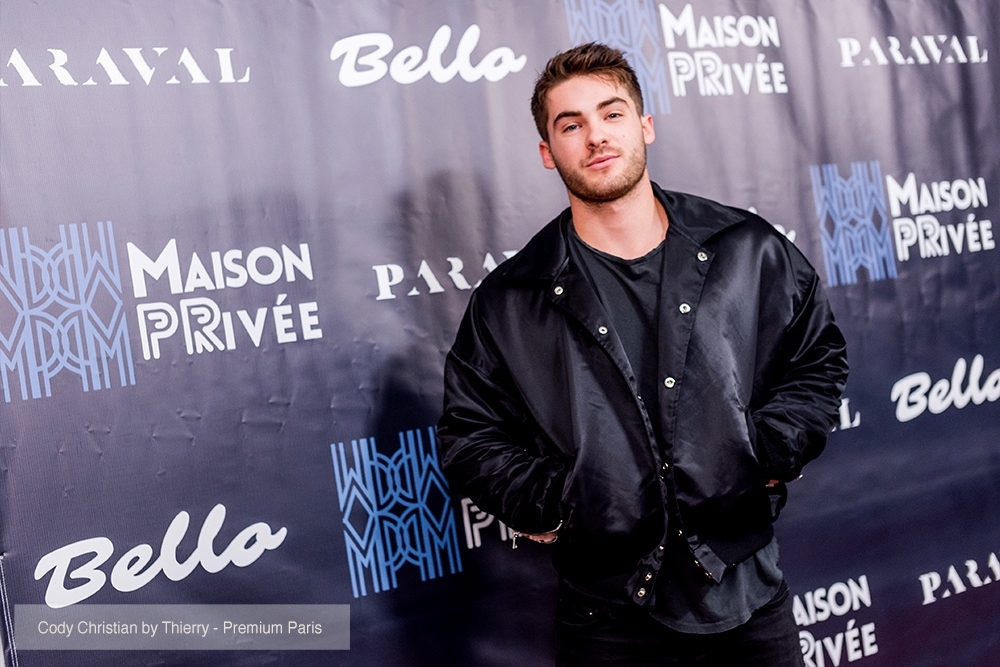 Actor Cody Christian attends the Bello and Maison Privee party at Hills Penthouse wearing jacket from Paraval (@paraval.us)