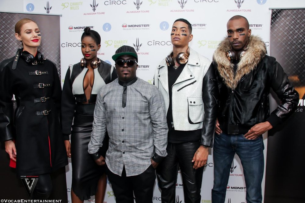 Alhassan Toure (center) flanked by models