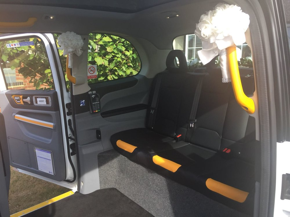 White Electric Wedding Cab Hire