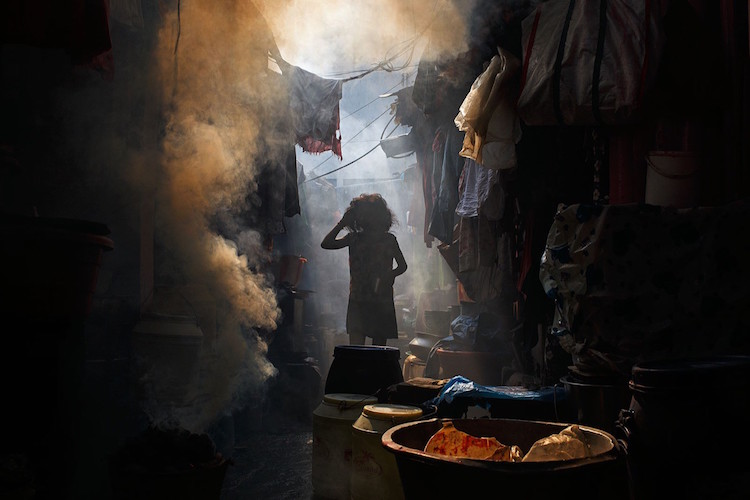 A smoky alleyway hidden somewhere in Central Kolkata, India. Photo by Maciej Dakowicz