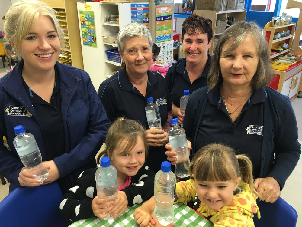 Children and teachers at Edmonton Community Kindy, with water