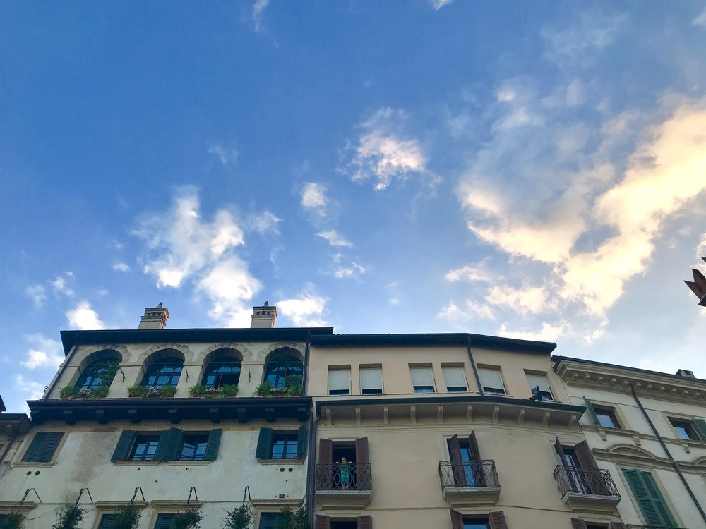 magic hour and boy on balcony in Verona