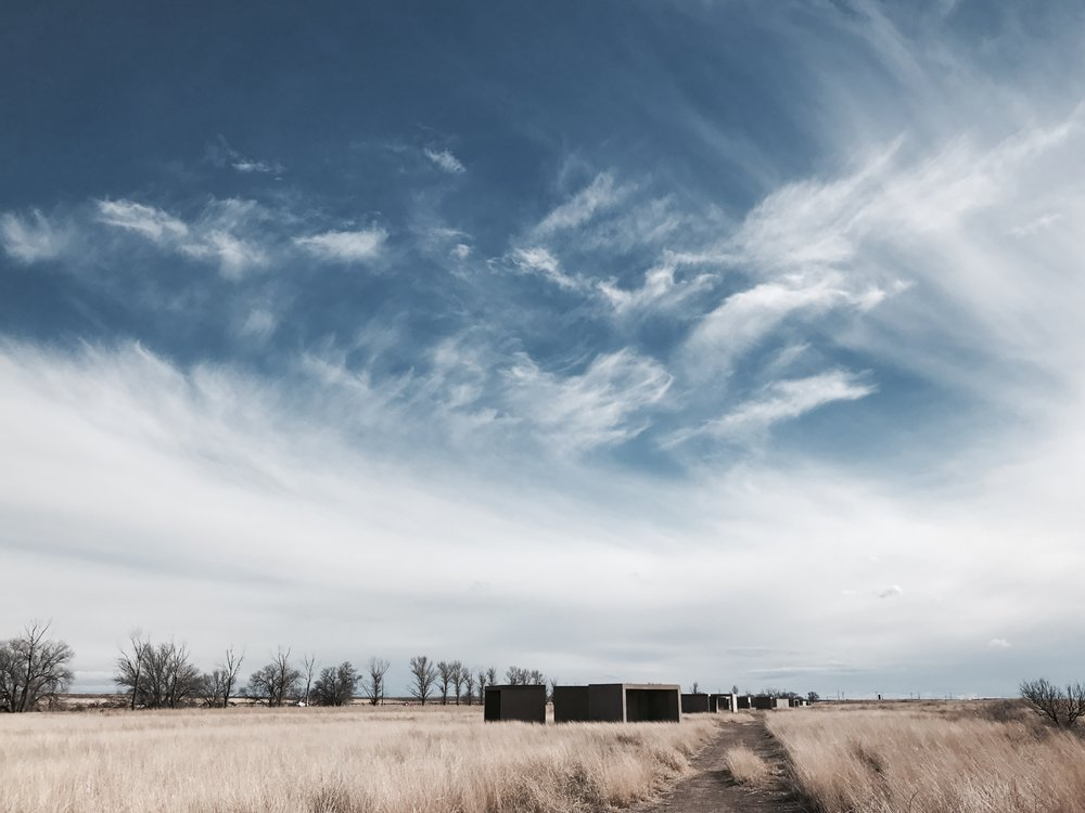 streak of clouds in sky at Chinati Foundation in Marfa
