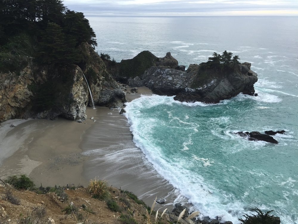 on my solo road trip to Big Sur, I stand watch at McWay falls as the tide comes in