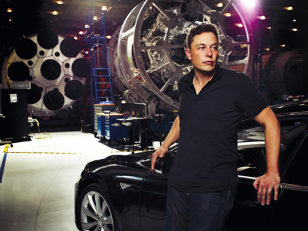 Elon Musk and a Tesla Model