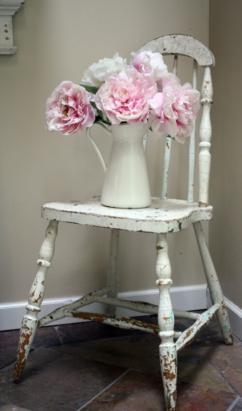 A chair covered in Ivy and Flowers with a tea pot and cup… I see it clearly.