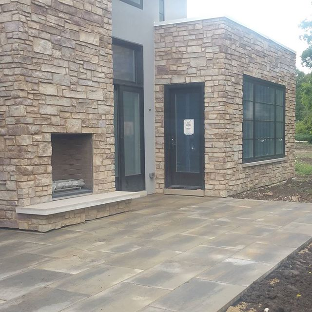 Elysian Way Back Patio #elysianway #homesbyinsignia #deerfield #northshorenewhouses #outdoorfireplace  #newconstruction