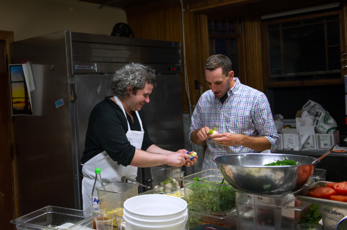 Cleaning radishes with Maxime Bilet. Photo Credit: Ken Goodman
