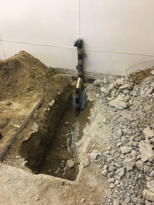 Week Three - Trenching for plumbing is underway. It's unnerving to see an existing floor all dug up, but this mess is a critical part of the project.