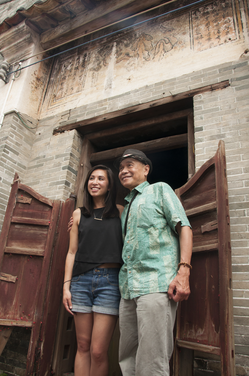 Michelle and Al Cheng in front of her ancestral home