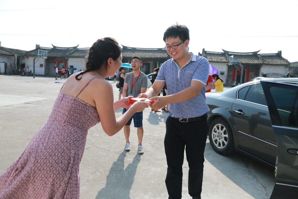 Thanking a local official, who assisted with finding the village, with a gift of American ginseng