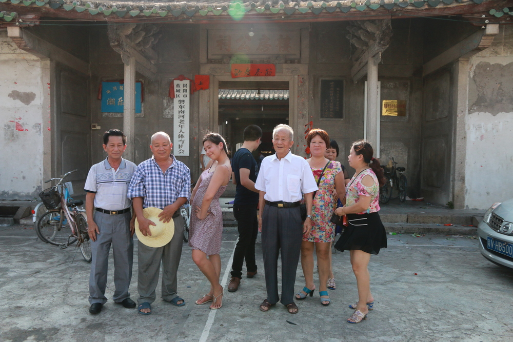 Getting ready for a family group photo in front of ancestral hall