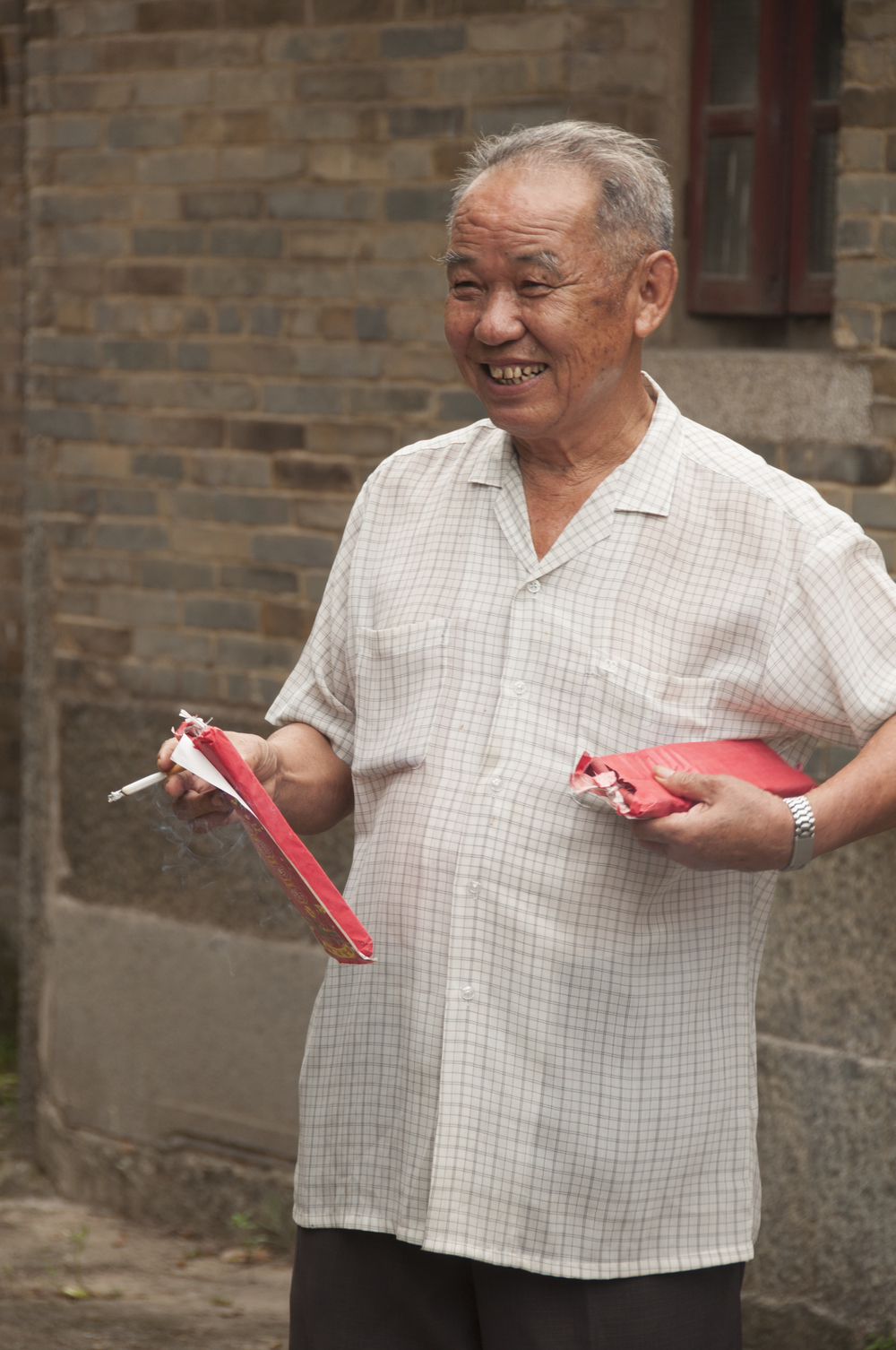 My great-uncle about to light firecrackers
