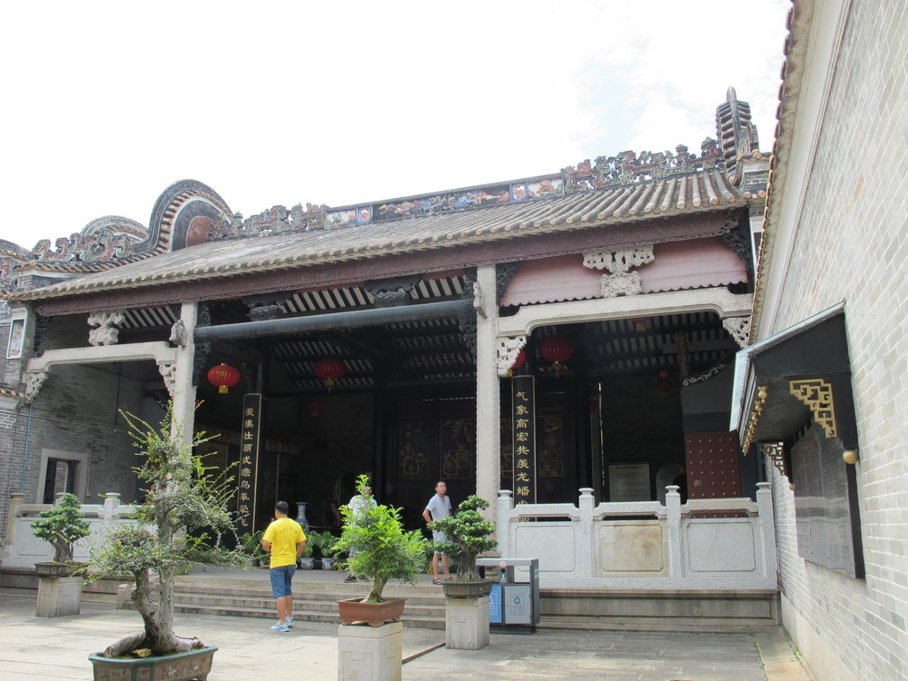 Showcasing the elaborate architecture of the roof, signifying a scholar's house.