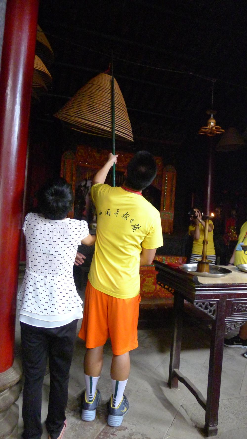 Hanging up a 30-day incense burner.