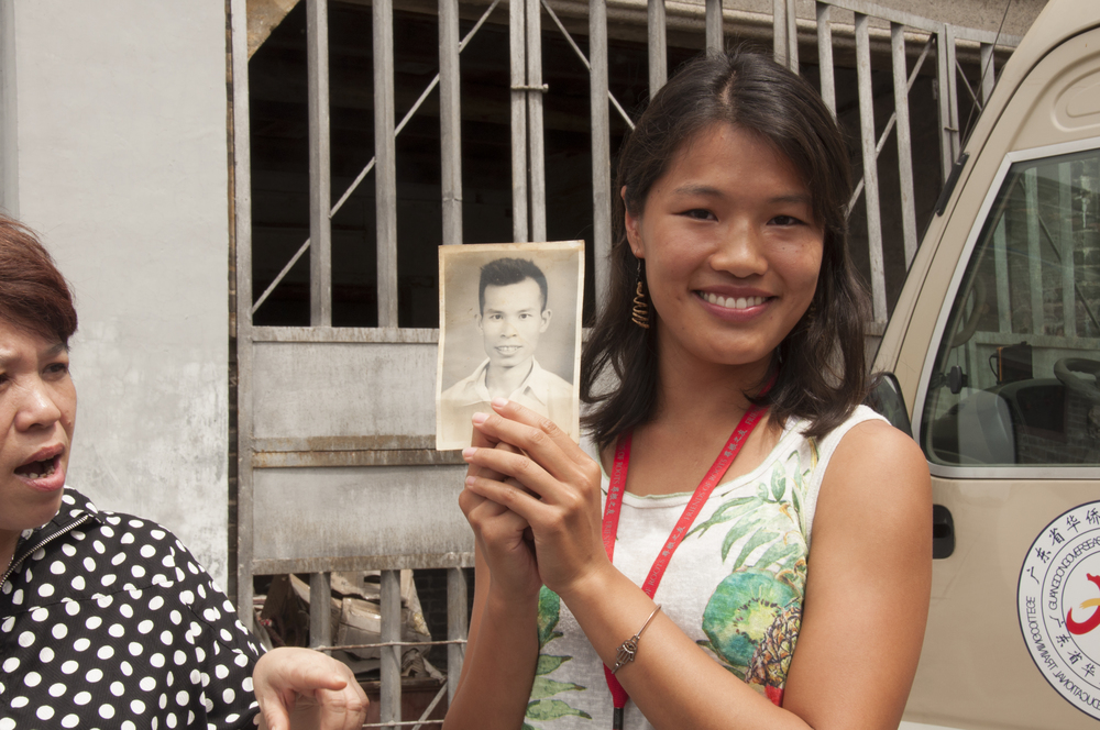 "Holding up a photograph of my maternal grandfather ""gong gong"". I first saw this picture in my grandmother's home when I visited China as a student abroad in 2010."