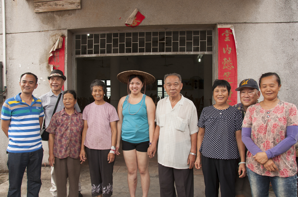 With my paternal great-uncle and villages in front of the community hall