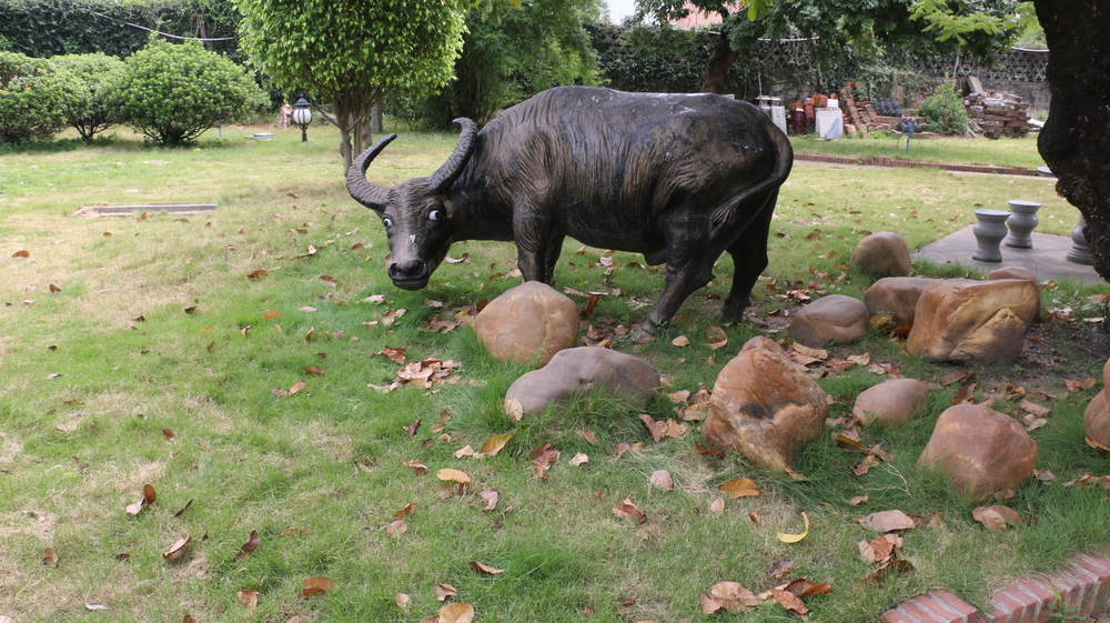A statue of an ox in the gardens.