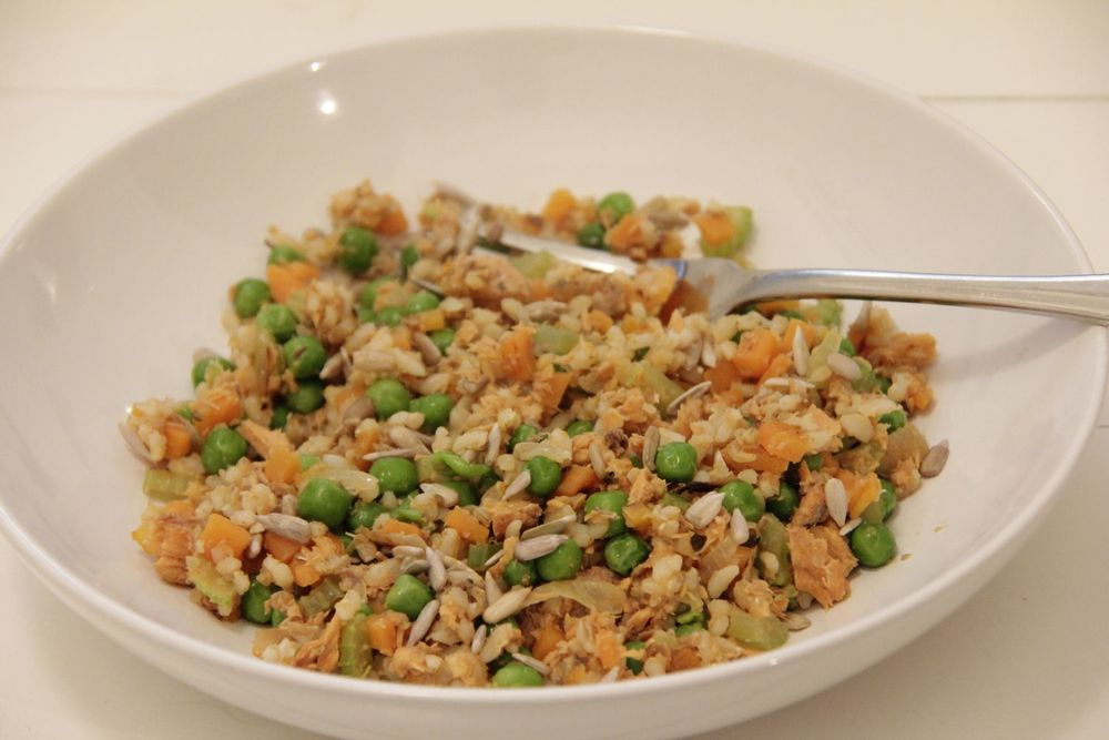 Recipe for one person - warm salad of tinned salmon with rice, peas, celerry and carrot with sunflower seeds