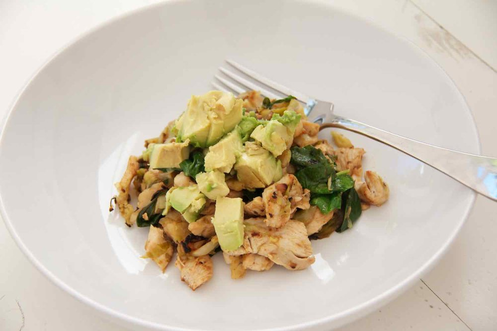Chicken panfried with lemon & spinach and topped with avocado