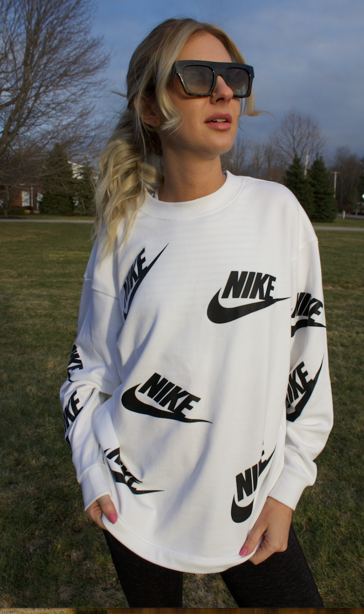 looking up nike sweatshirt.png