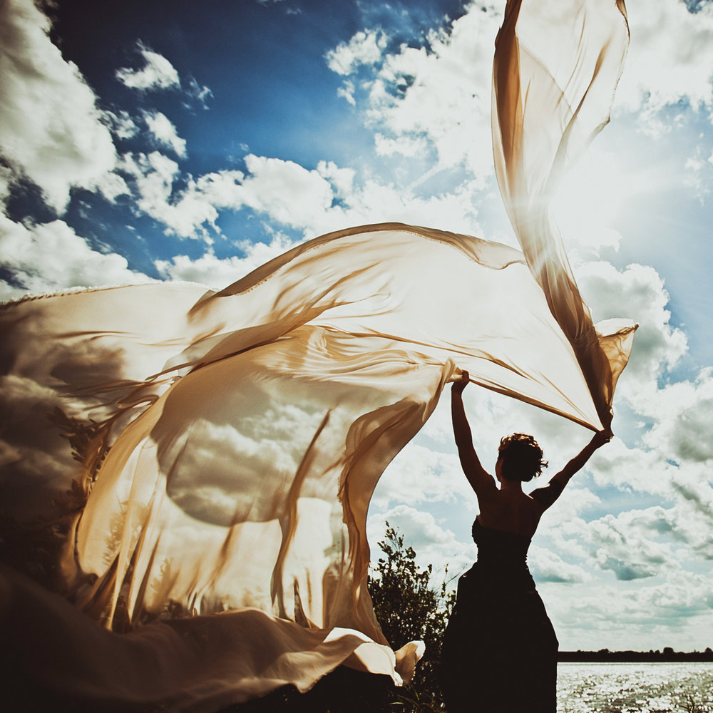 White fabric Sun Woman.JPG