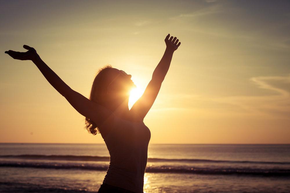 Happy Woman Sun Arms Up.jpg