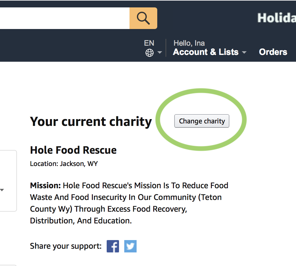 Find the Change charity button in the top right of the screen