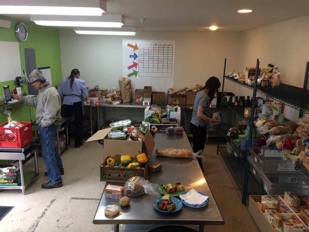 Joe, Molly and Hannah sorting through rescues and preparing food boxes at the Hub.