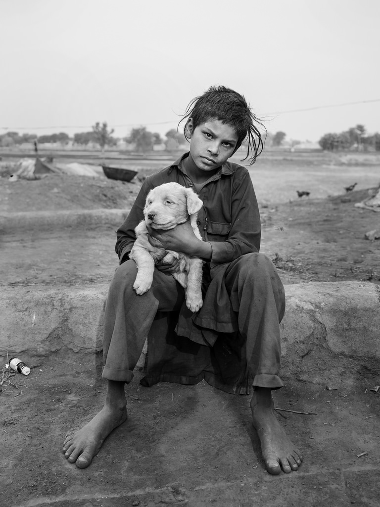 Young boy with his dog in Sahiwal, Pakistan (2016)