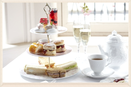 Traditional Afternoon Tea at the Mix   Traditional Afternoon Tea                     £6.95 Choice of Sandwiches (Tuna & Cucumber, Roast Ham or Cheddar Cheese). Freshly Baked Sultana Scone served with Fresh Cream & Strawberry Jam, Fresh Cream Victoria Sponge and a Pot of Tea or Filter Coffee.   Afternoon Tea & Glass of Prosecco        £11.95 Glass of Prosecco, Choice of Sandwiches (as above). Freshly Baked Sultana Scone served with Fresh Cream & Strawberry Jam, Fresh Cream Victoria Sponge and a Pot of Tea or Filter Coffee.   Children's Afternoon Tea                      £4.95 Choice of Sandwiches (Tuna, Roast Ham or Cheddar Cheese). Freshly Baked Sultana Scone served with Fresh Cream & Strawberry Jam, Fresh Cream Victoria Sponge with a Choice a simply fruity or soft drink.   Traditional Afternoon Tea at the Mix Afternoon Tea & Glass of Prosecco        £11.95 Glass of prosecco, Choice of Sandwiches (as above). Freshly Baked Sultana Scone served with Fresh Cream & Strawberry Jam, Fresh Cream Victoria Sponge and a Pot of Tea or Filter Coffee.   Afternoon Tea for 2 with Prosecco          £29.95 Bottle of Prosecco, Choice of Sandwiches (as above). Freshly Baked Sultana Scone served with Fresh Cream & Strawberry Jam, Fresh Cream Victoria Sponge and a Pot of Tea or Filter Coffee.   Afternoon Tea for 2 with Champagne     £49.95 Bottle of Moet & Chandon , Choice of Sandwiches (as Above). Freshly Baked Sultana Scone served with Fresh Cream & Strawberry Jam, Fresh Cream Victoria Sponge and a Pot of Tea or Filter Coffee.