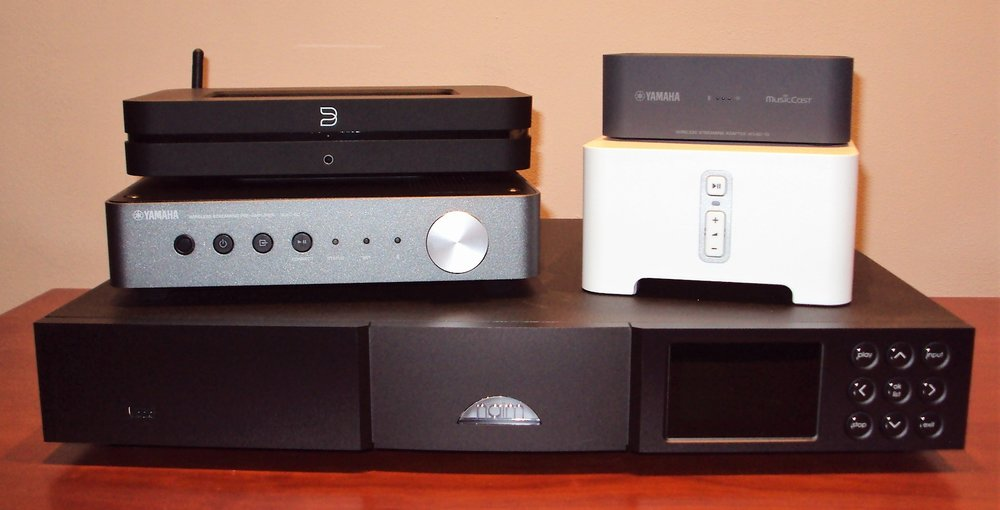 Streamers - Clockwise from top left: Bluesound Node 2 £499, Yamaha WXAD-10 £149, Sonos Connect £349, Naim ND5XS £2430, and Yamaha WXC-50 £329