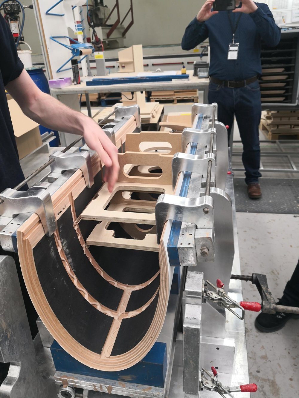 With the cabinet prised apart by metal jaws the matrix is positioned and glued into place. When the jaws are released the natural spring of the cabinet form will add compression to the matrix