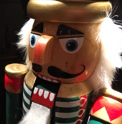 a traditional wooden nutcracker.. put a nut in his mouth, pull the lever on his back and hey presto! you've cracked it!